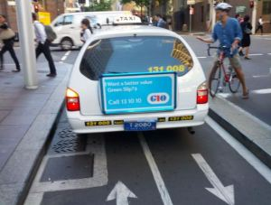 taxi in bike lane